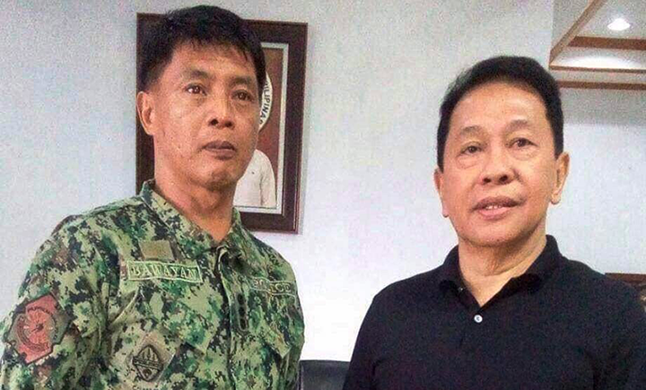 On the left is PCol Bawayan when he paid a courtesy call to Sulu Governor Adbusakur Mahail Tan (right).